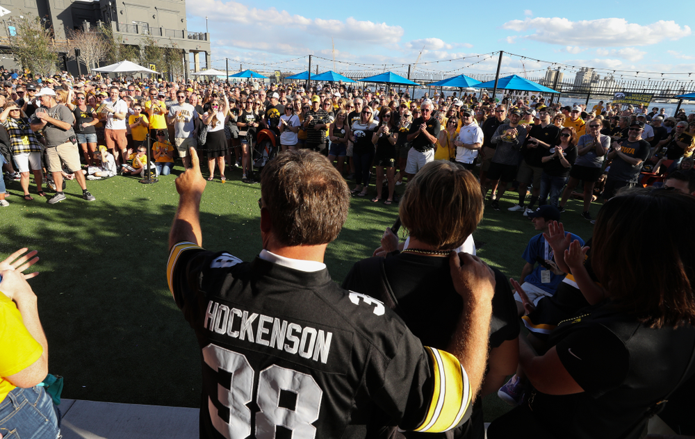 "Fans chant ""One More Year"" as the Voice of the Hawkeyes Gary Dolphin introduces the family of Iowa Hawkeyes tight end T.J. Hockenson (38) during the Hawkeye Huddle Monday, December 31, 2018 at Sparkman Wharf in Tampa, FL. (Brian Ray/hawkeyesports.com)"