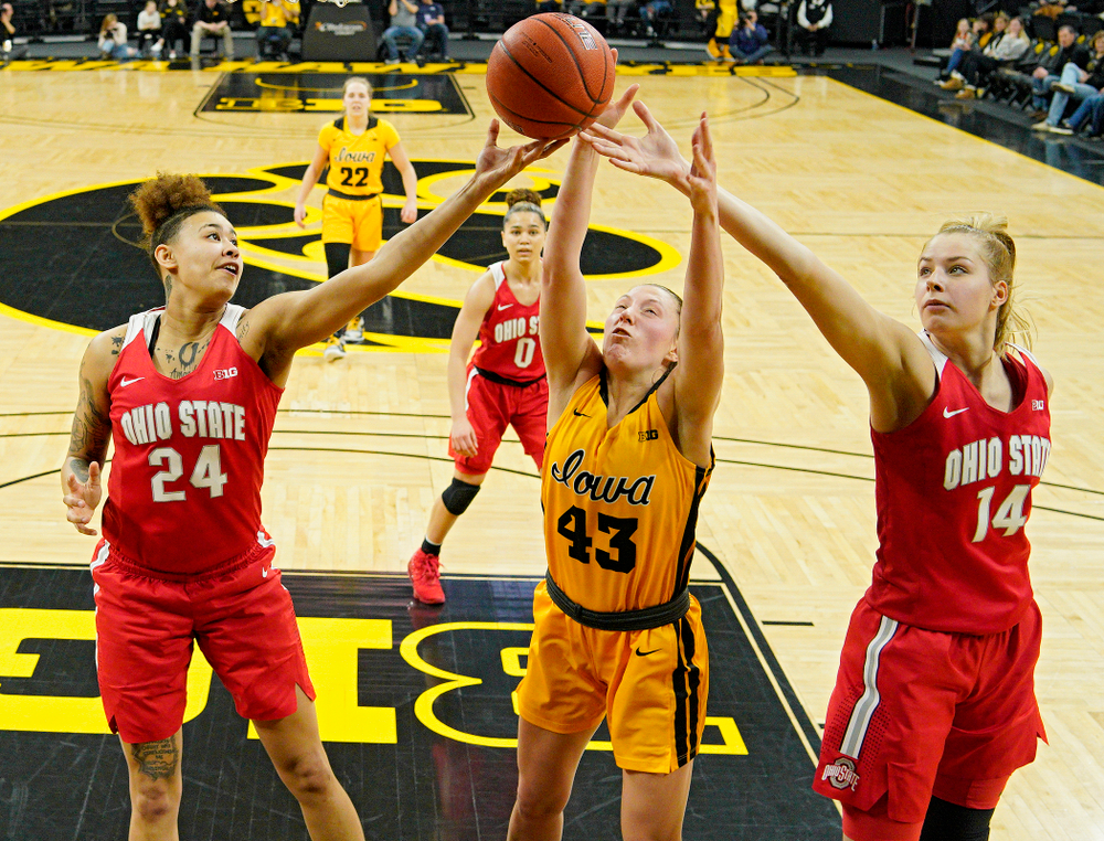 Iowa Hawkeyes forward Amanda Ollinger (43) battles for a rebound during the second quarter of their game at Carver-Hawkeye Arena in Iowa City on Thursday, January 23, 2020. (Stephen Mally/hawkeyesports.com)